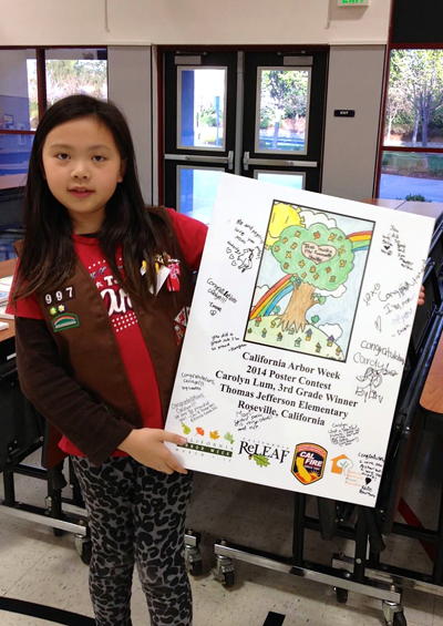 Girls in Carolyn Tum's Girl Scout troop wrote their congratulations on a copy of the poster featuring her winning drawing.